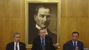 Turkish Prime Minister Recep Tayyip Erdogan (center), accompanied by deputies Bulent Arinc (left) and Bekir Bozdag, speaks during a news conference at Ataturk International Airport in Istanbul on June 3.